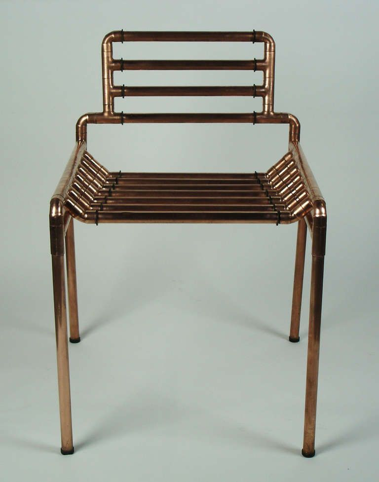 An architectural copper tubing chair
