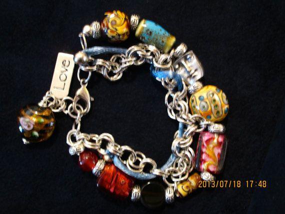 One of a kind Jewelry. Handmade glass, venetian and porcelain bracelets and earrings.
