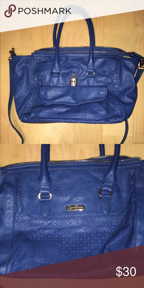 blue two-strap bag- Jessica Simpson blue Jessica Simpson purse with eyelet cutout design. has a crossbody strap & a strap to hold with hands/ wear over shoulder. Bags
