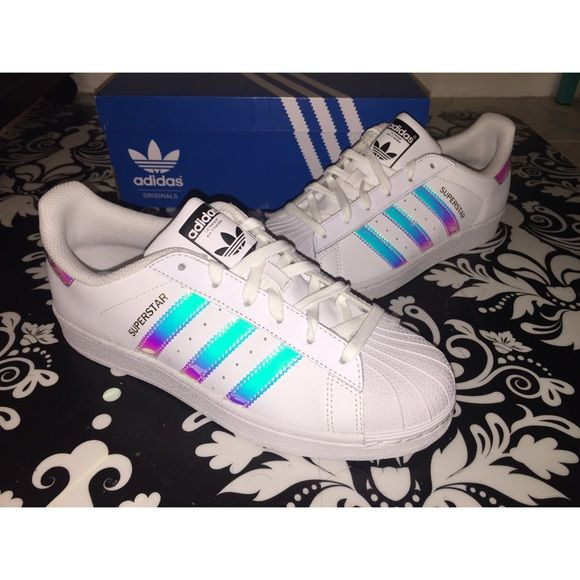 These are the adidas superstar limited edition holographic metallic pink  purple and baby blue on a white sneaker.