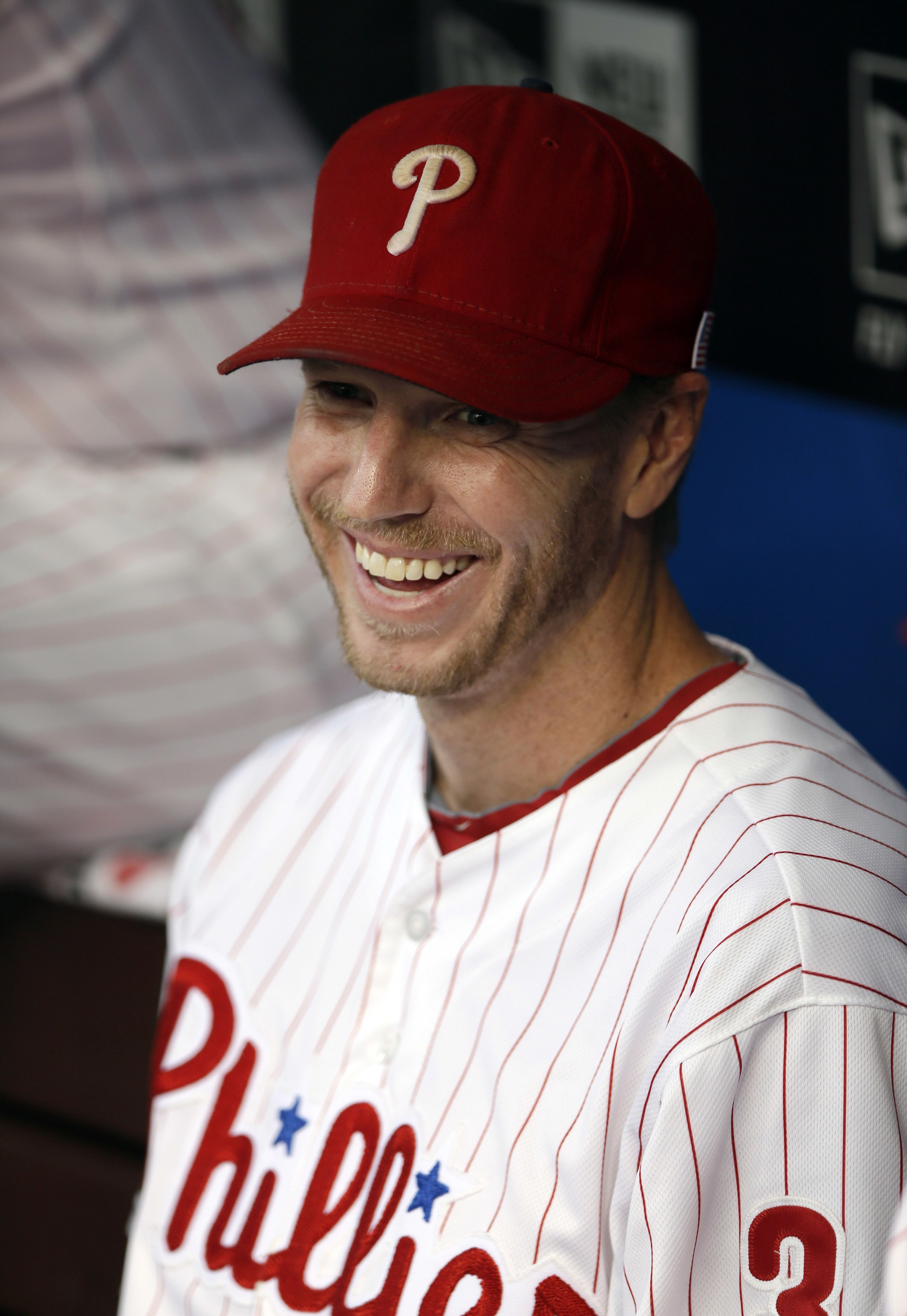 Roy Halladay Enjoys A Moment In The Phillies Dugout In September 2013 Phillies Phillies Baseball Baseball Dugout