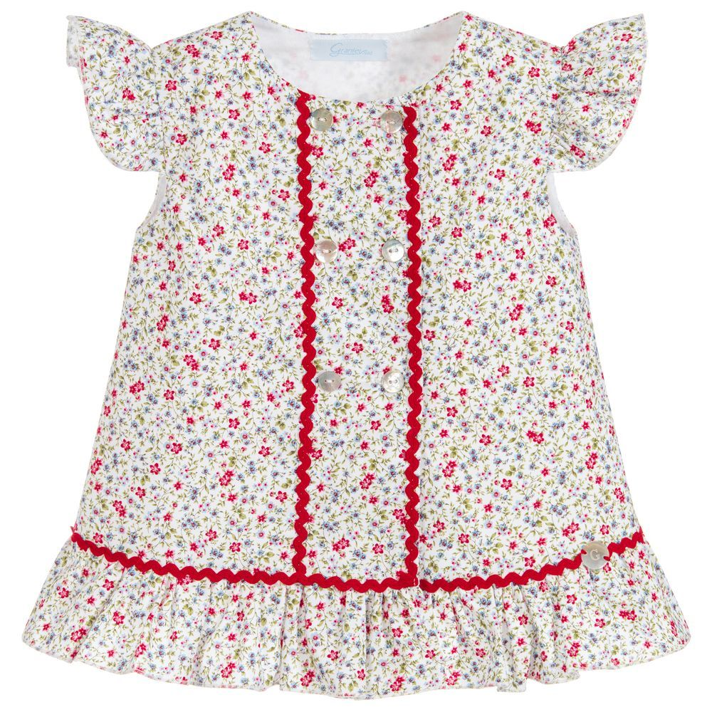 567931ee97fe Baby girls organic cotton dress and knickers set by Artesania Granlei, with  a beautiful floral print. This pretty dress has a red rick rack trim and ...