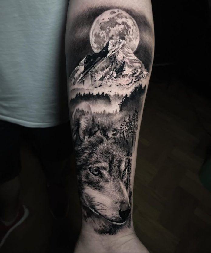 Photo of 31. Tatouage de loup au milieu de montagnes et forêts sur avant bras