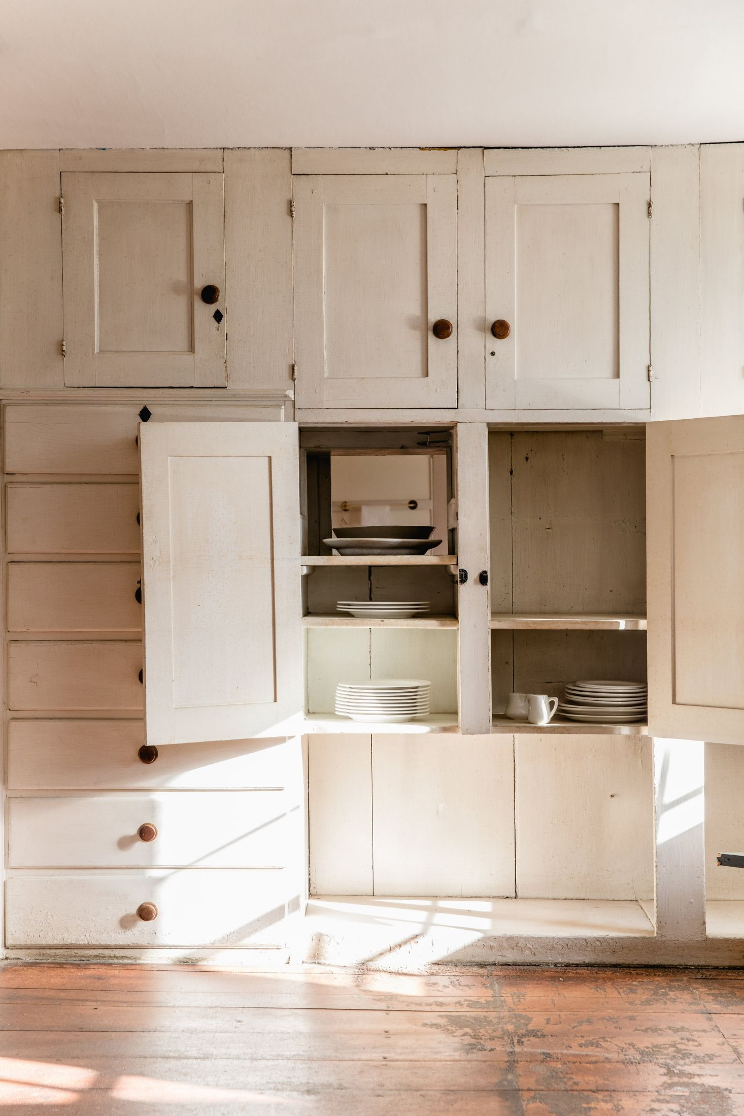 A china cabinet separating two dining rooms