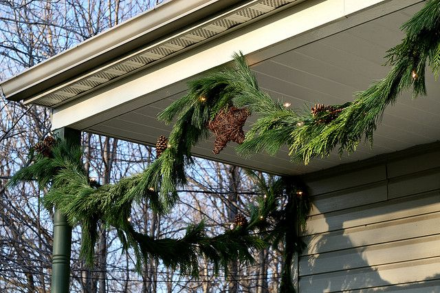 Fresh Pine Garland with Grapevine Stars, Pine Cones and White Lights by Chiot's Run, via Flickr