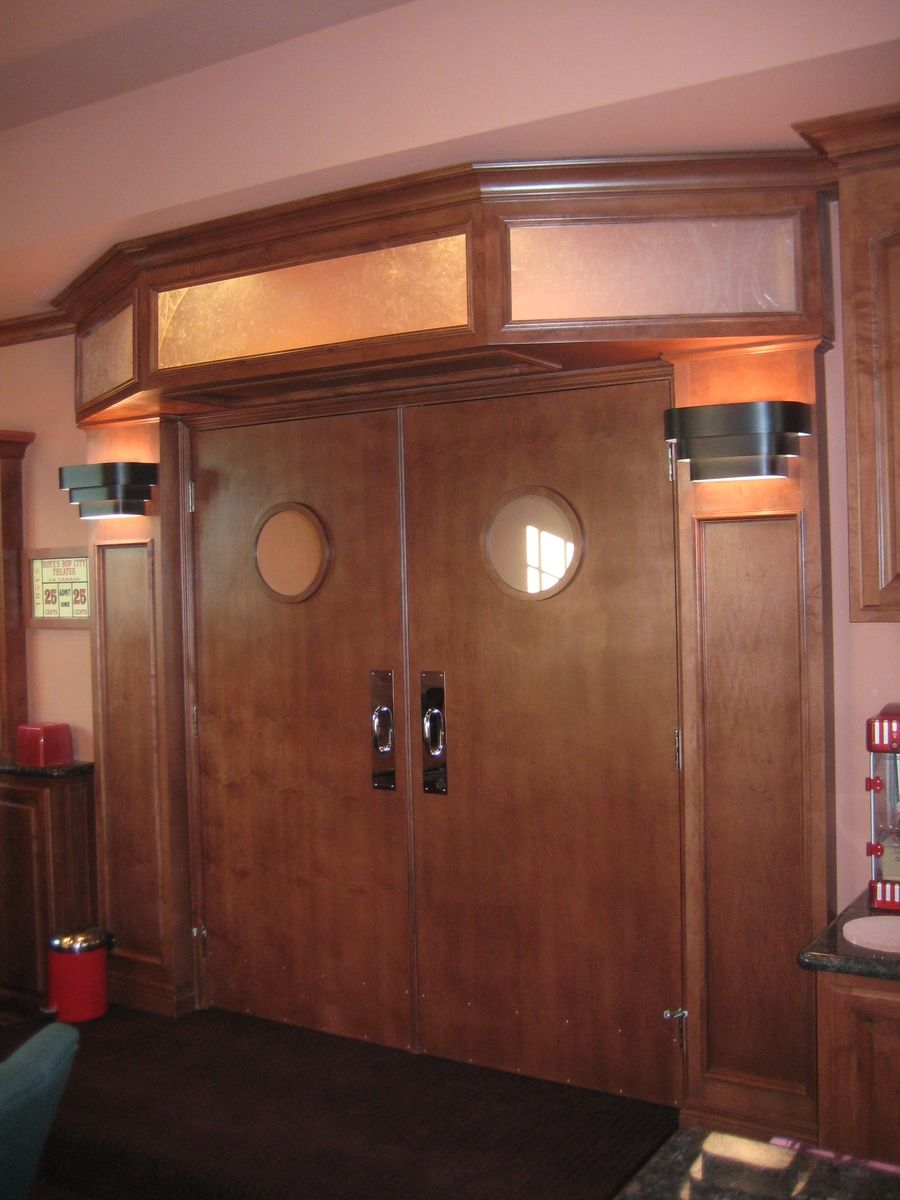 Custom home theater doors now that 39 s just so cute dream for Unique home theater