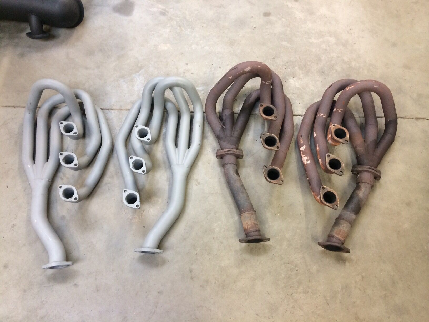 New ceramic coated exhaust manifold versus old leaky rusty ones. All original parts will be kept though.
