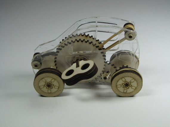Gears Used In Toys : This is a transparent up scaled windup toy it has
