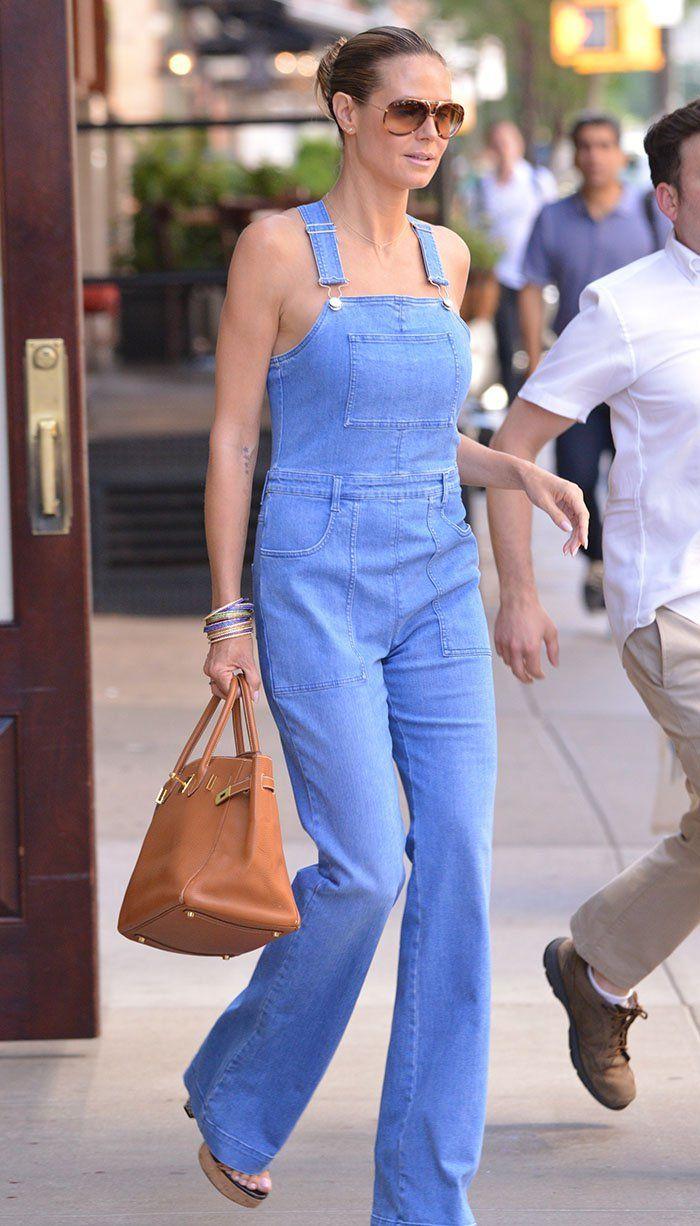 Heidi Klum leaving her hotel in denim jumper in New York on June 16, 2016