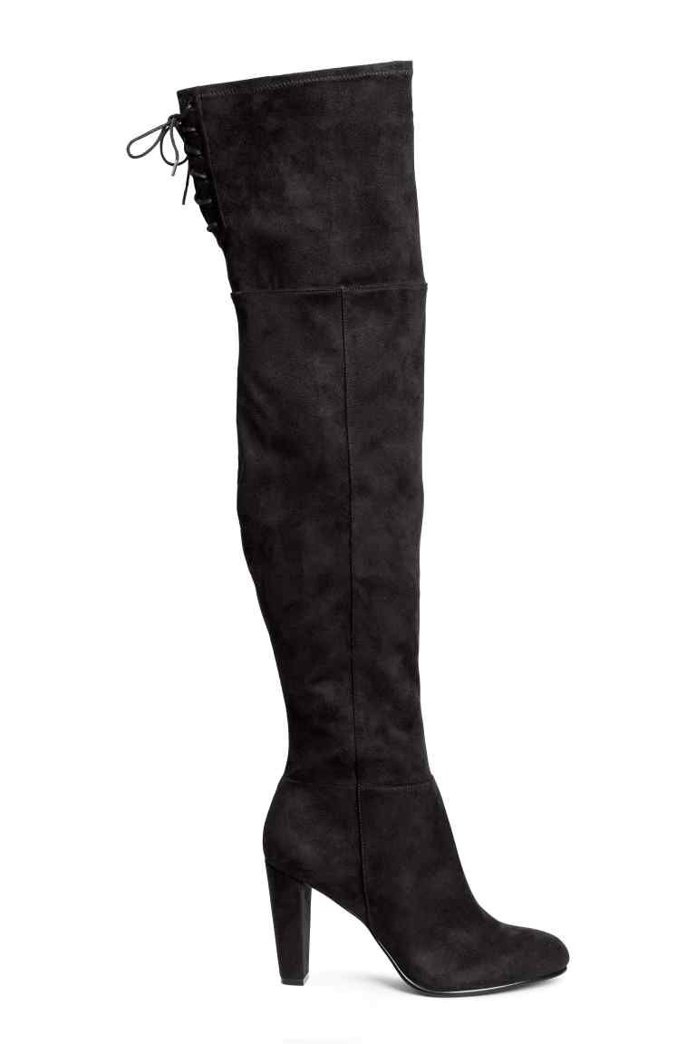 Thigh boots: Thigh boots in imitation suede with a soft shaft with a slit and lacing at the top, a zip that extends halfway up the shaft and rubber soles. Heel 8.5 cm.