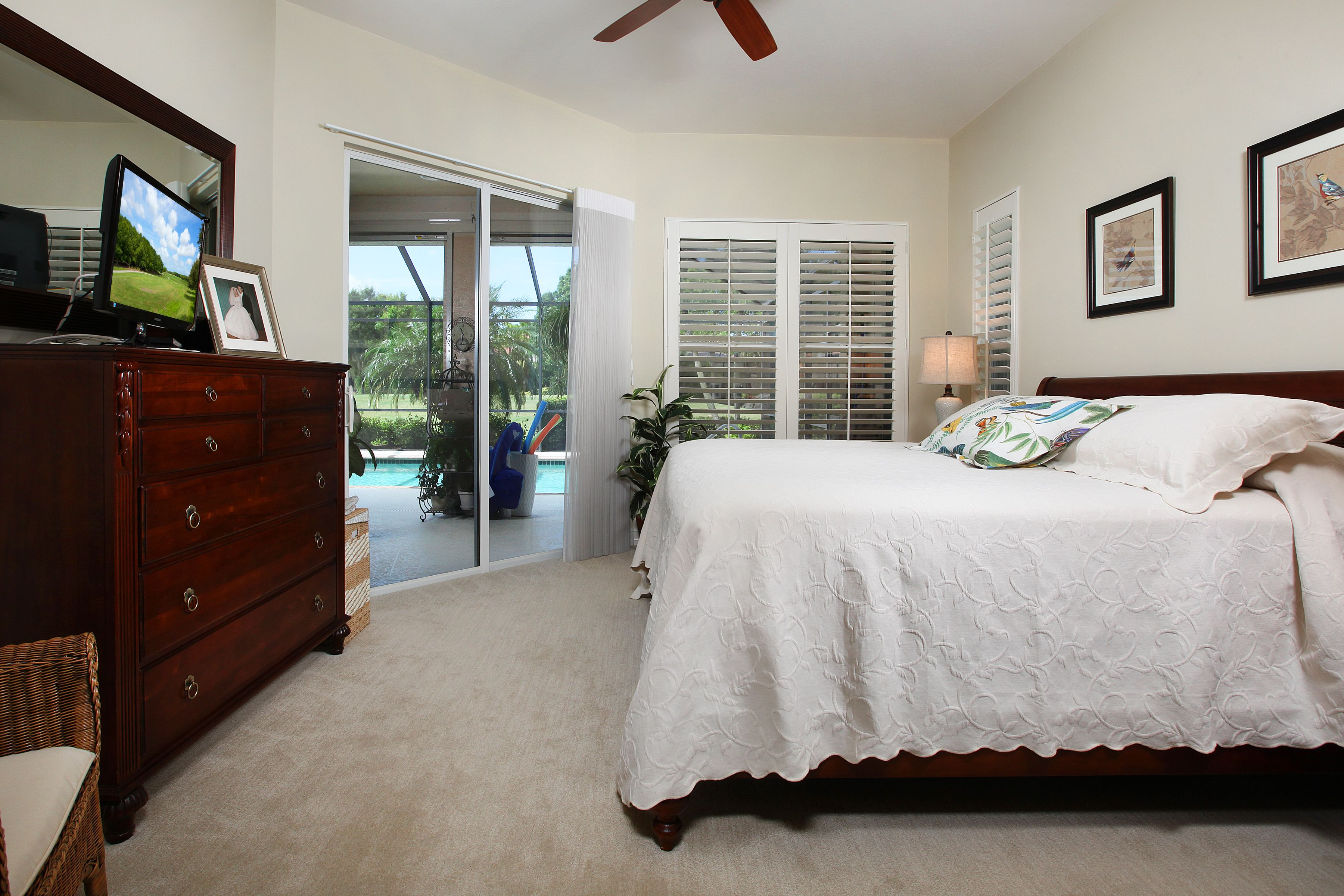 Master bedroom has spacious custom closets and wood plantation shutters.