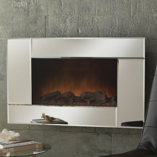 Mirrored Wall Fireplace with Remote from Midnight Velvet®. The crisp, modern lines of the mirrored frame showcase the warm glow within. www.midnightvelvet.com