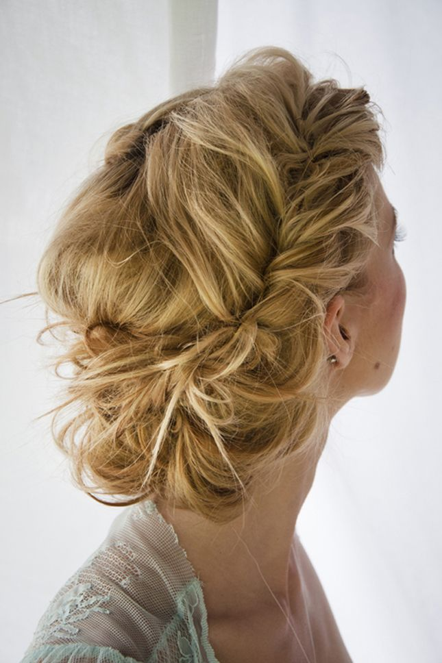 Wedding hair up-do tucked and rolled in the back and sides.