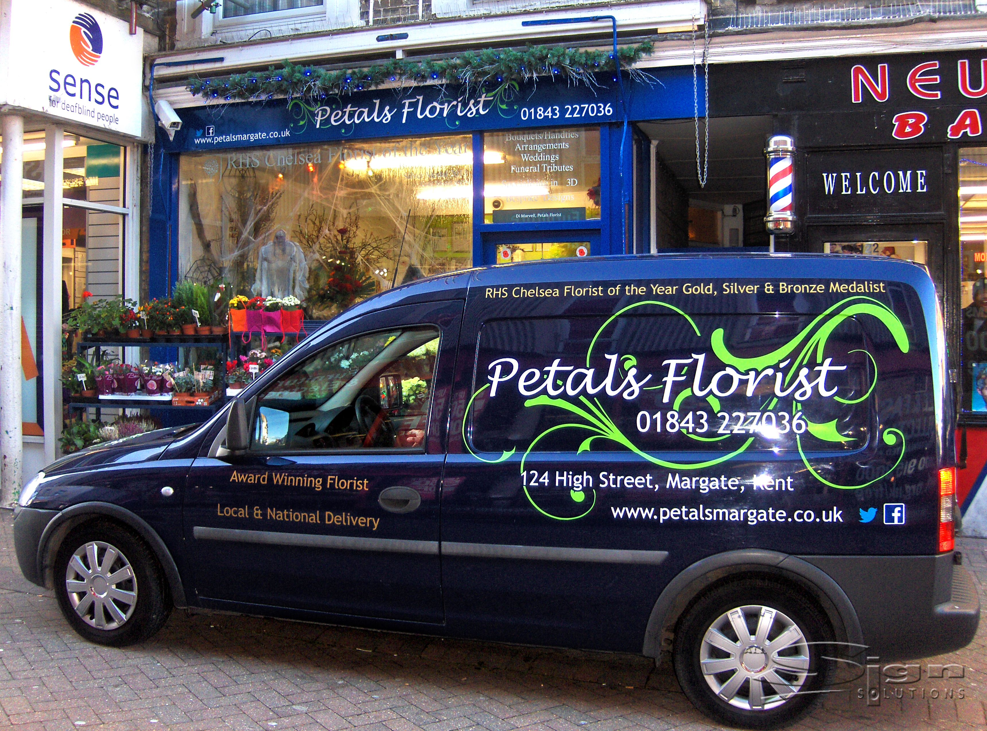 09bbd0e39bed84 Petals Florist in Margate vehicle livery design uses a handwritten styled  font and the colours blue and white. The vivid green swirl stands out on the  dark ...