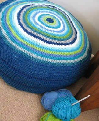 This is an easy crochet for a beginner.  Starts off fast, but the outer circles take a long, long time to get around.  [crochet pouf]