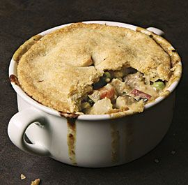 Classic Chicken Pot Pie. This is the definitive pot pie recipe: a creamy chicken stew loaded with onions, peas, mushrooms, and carrots, and baked under a rich, flaky crust. It's comfort in a bowl. Great reviews.