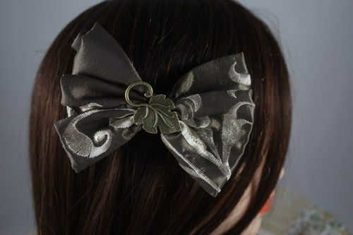 Embroidered Green Bow with Antique Leaf Embellishment