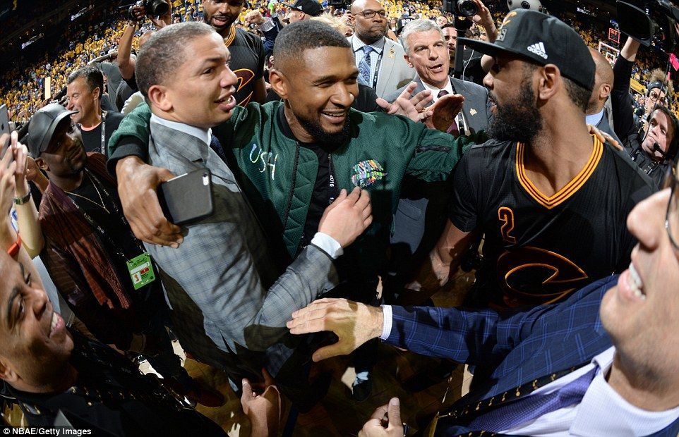 Music artist Usher (centre) was at Oracle Arena to celebrate alongside Cleveland  Cavaliers head coach Tyronn Lue (left) and Irving (right) 0124b2c7f