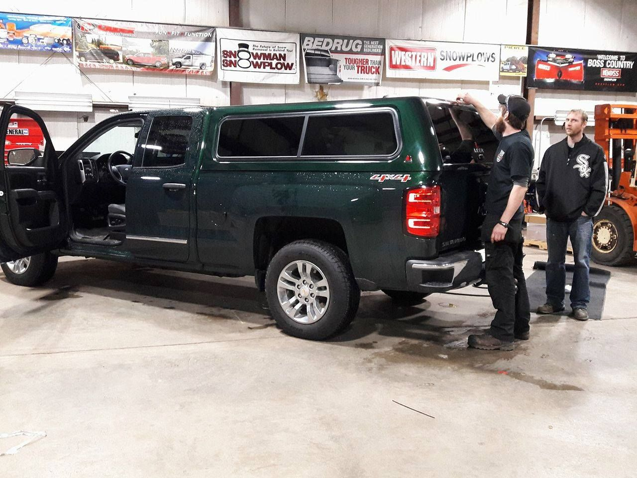 Green Leer truck topper cap installed on a 2014 Chevy