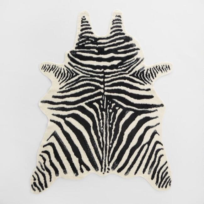 Our Animal Friendly Faux Skin Rug Recreates The African Zebra S Bold Black Stripe Patterns On A Creamy Ivory Ground In Add Faux Zebra Rug Zebra Rug Zebra Hide