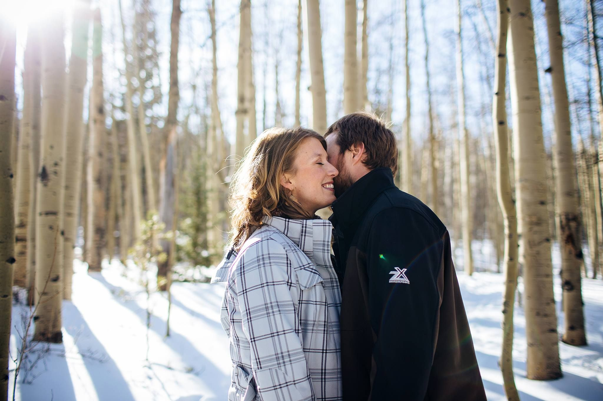 Winter engagement session in the aspens. Bailey, Colorado.