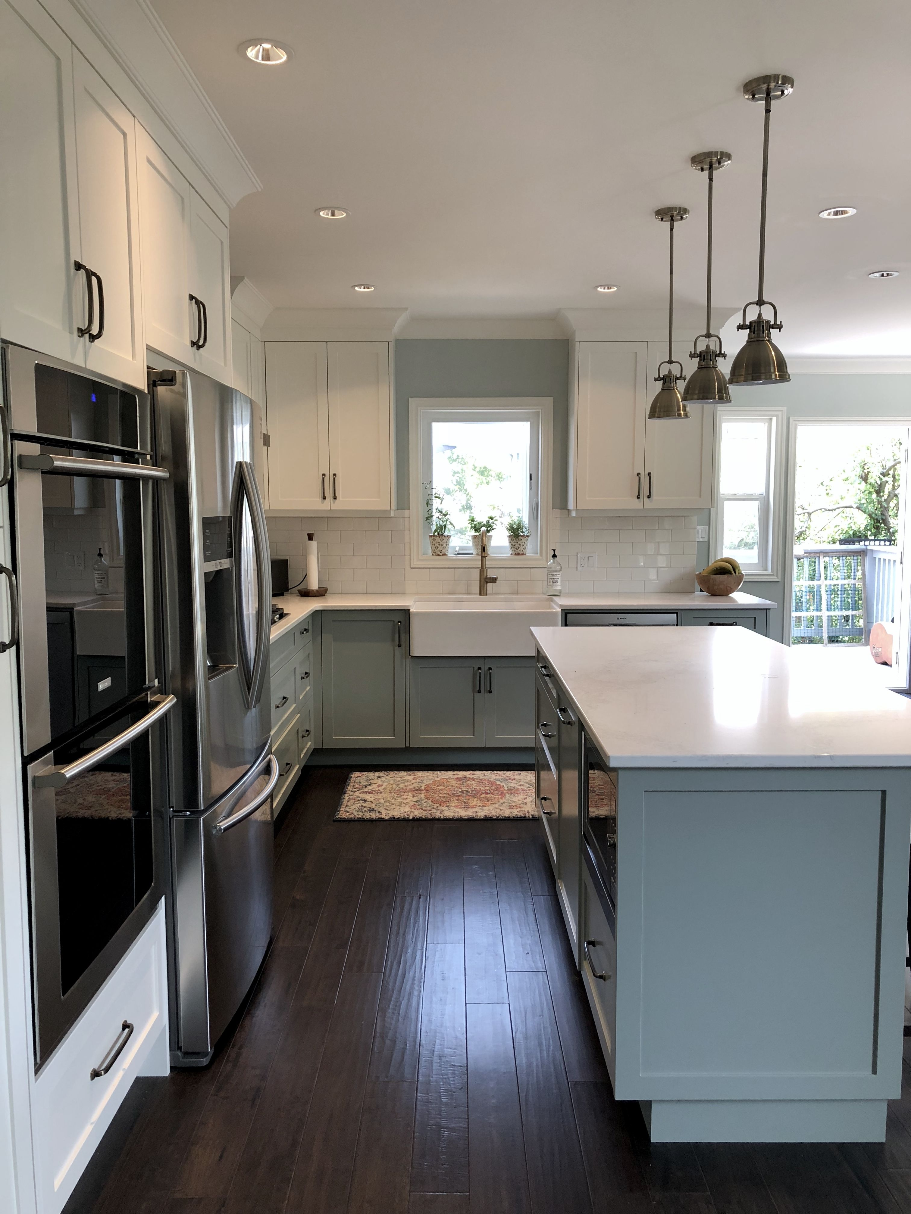 Modern Country Kitchen With Blue Grey And White Two Tone Cabinets Antique Br Kitchen Cabinets Grey And White Gray And White Kitchen Two Tone Kitchen Cabinets