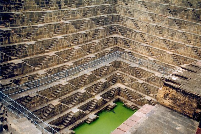 The Chand Baori Stepwell in India     Built sometime in the 9th century AD by King Chanda, the Chand Baori stepwell is located in the Abhaneri village of Rajasthan. Unique to India, there are an estimated 3,000 such wells throughout the northern part of the country. This one, however, is the largest and most beautifully ornate one. Going 13 stories deep, the well is descends some 65 feet into the ground and is adorned on three of its four sides by over 3,500 narrow steps, arranged in…