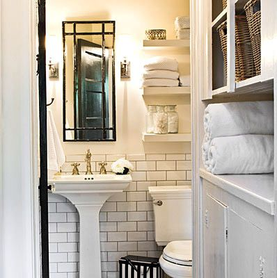 subway tile with dark grout, small square pedestal sink, and mirror