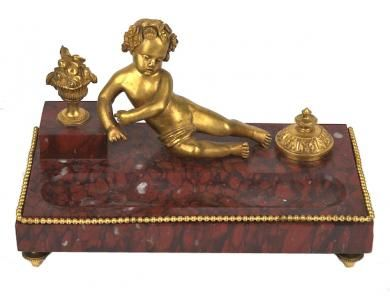 19th Century Rouge Marble Inkwell --   Charming French gilt bronze and rouge royale marble encrier ink well, from the late 19th Century, with a reclining bronze Putti. 10W x 5.5D x 6H. A fantastic desk accessory   Measurements: 10W x 5.5D x 6H