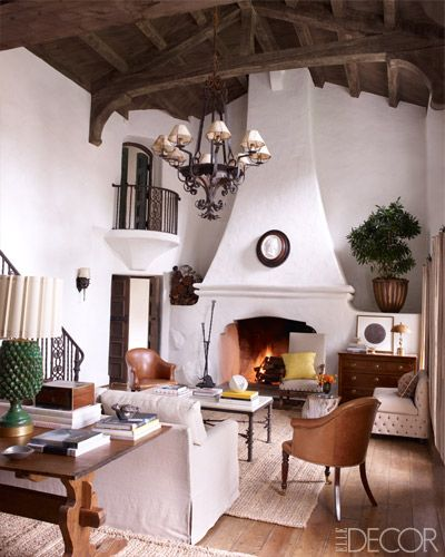 Reese's living room's wood ceiling, wrought-iron chandelier, and fireplace are original to the house.