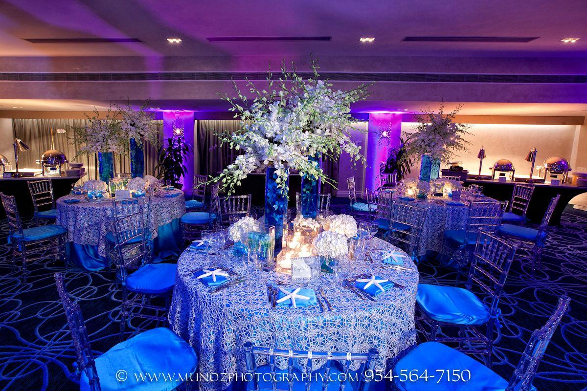 Blue Centerpieces Chairs Indoor Reception Wedding Photos