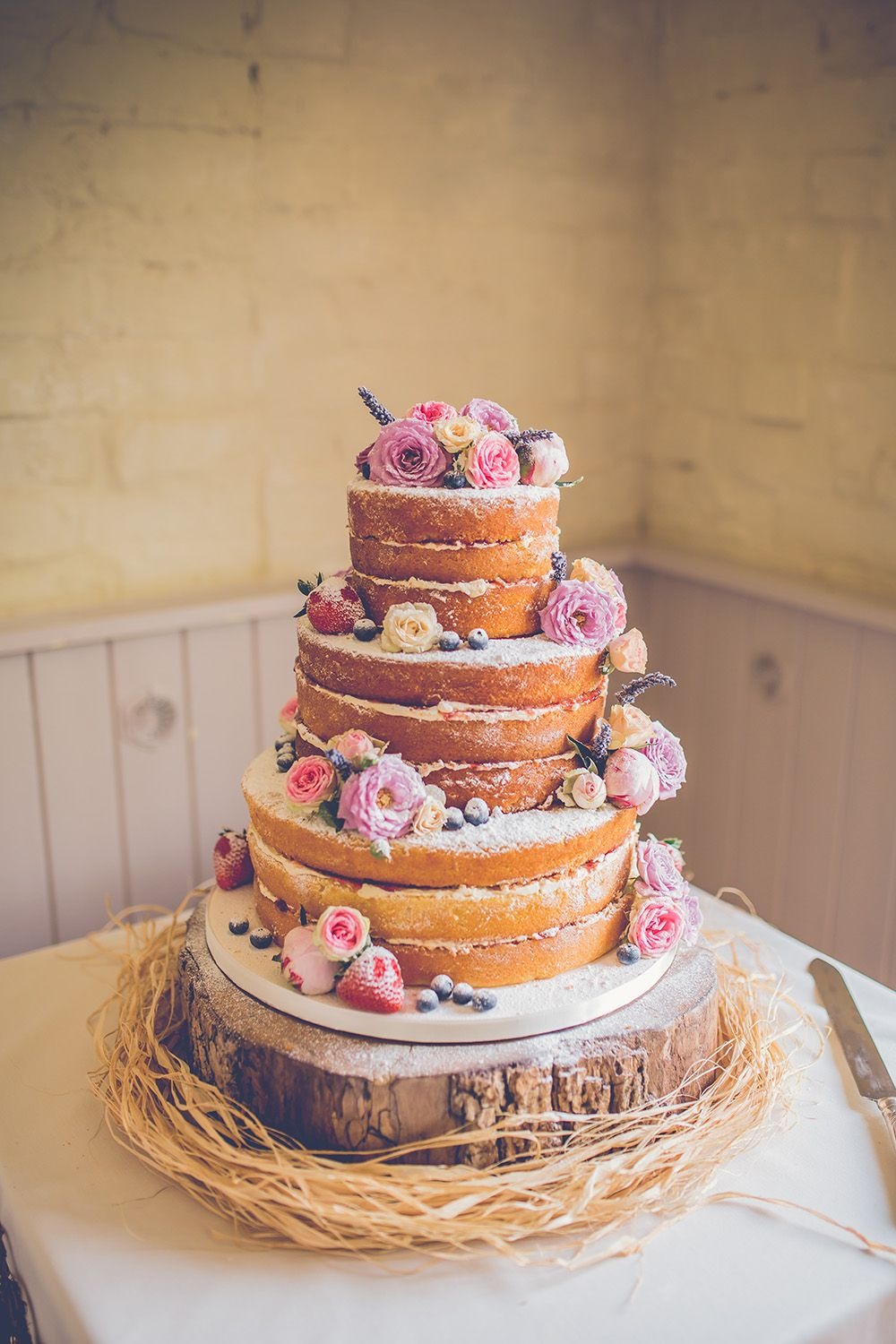 beach themed wedding cakes pinterest%0A Beautiful naked wedding cake on a wooden plate