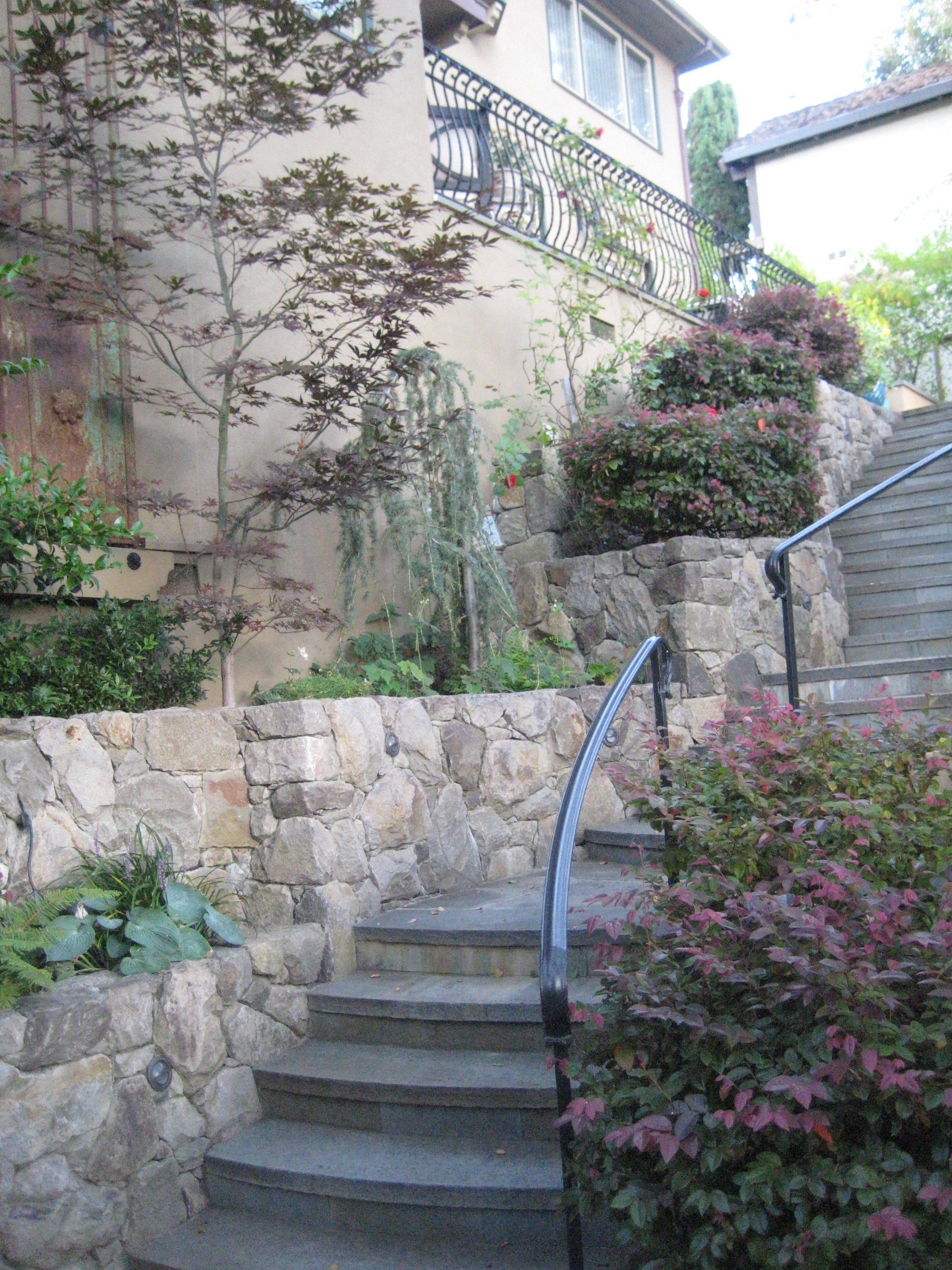 Garden Terraced With Stone Walls To Add Planting Area