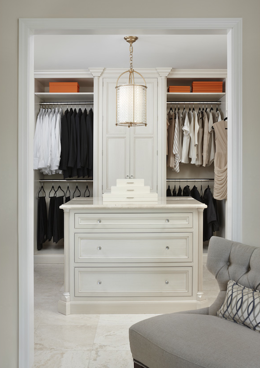 Marianne Jones: Classy walk-in closet design with floor to ceiling built-ins and clothes organized by ...