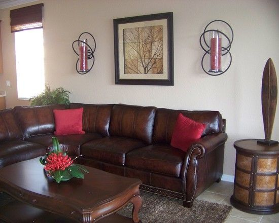 Traditional Brown Leather Sofa With Red Pillows Unique Wall Lamp And Darkwood Coffee Table