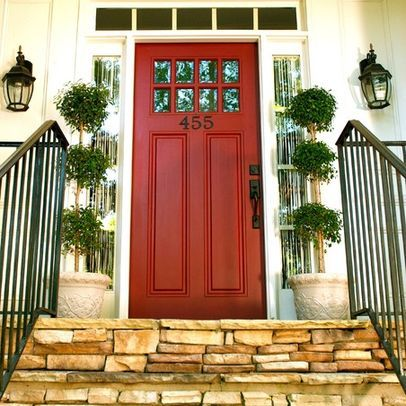 A pop of red and some fun numbers and topiaries make this front ...