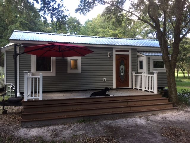 jarid s 32ft tiny house with main floor bedroom add l trailer deck rh pinterest com buying a new mobile home in florida