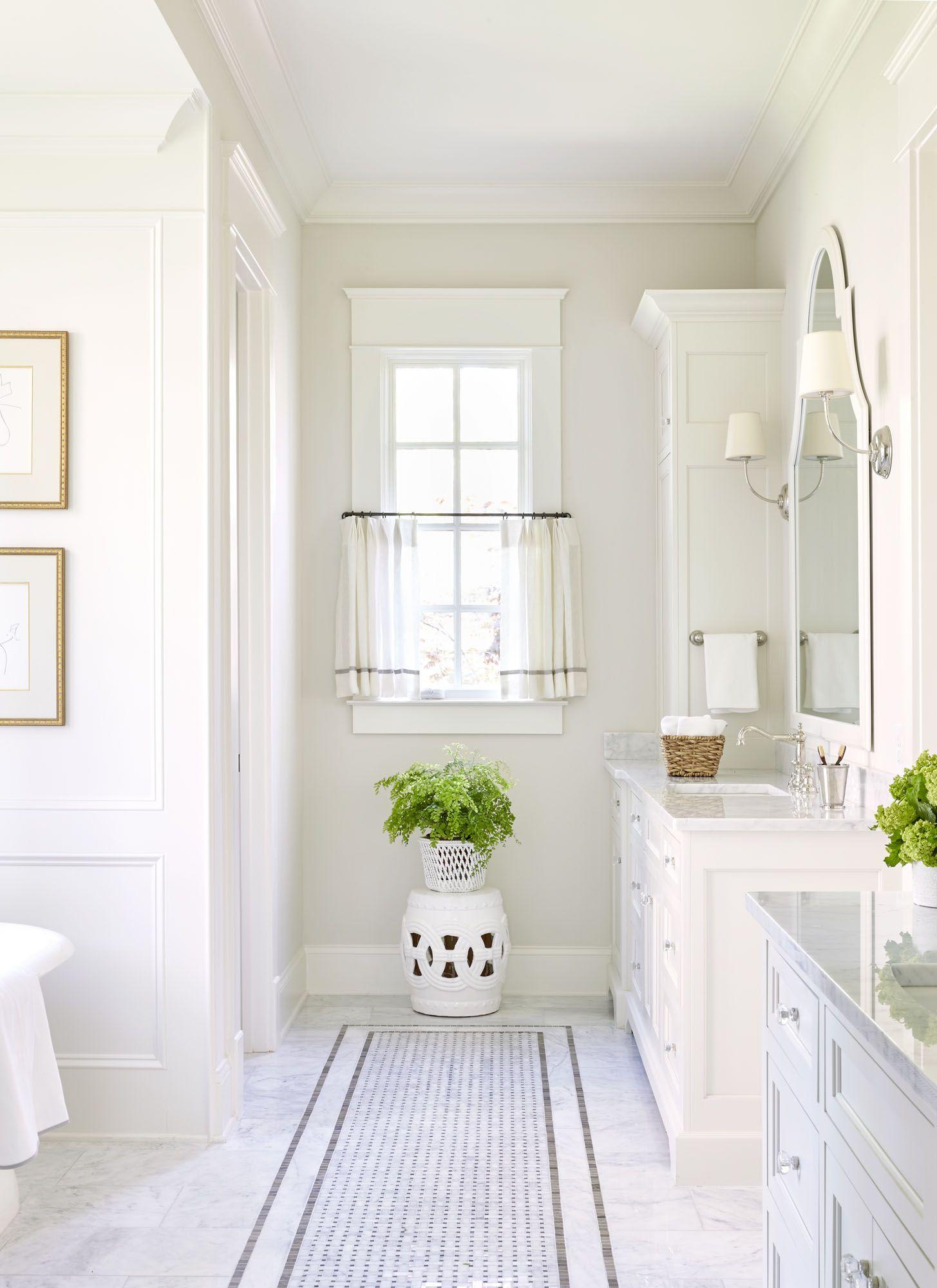 Sarah Bartholomew white classic bathroom with traditional design.