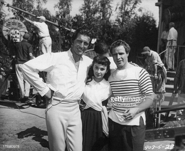 Actors (left to right) Michael Rennie (1909 - 1971), Jean Simmons (1929 - 2010) and Marlon Brando (1924 - 2004) on the set of ' Desiree', directed by Henry Koster, USA, 1954. Description from gettyimages.com. I searched for this on bing.com/images