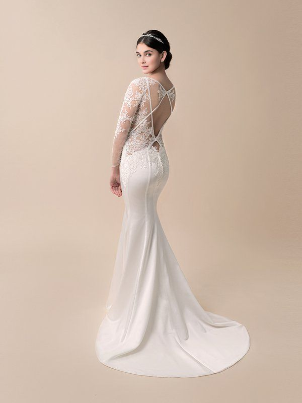 Sexy lace gown by @MoonlightBridal featuring our ENYA Headband