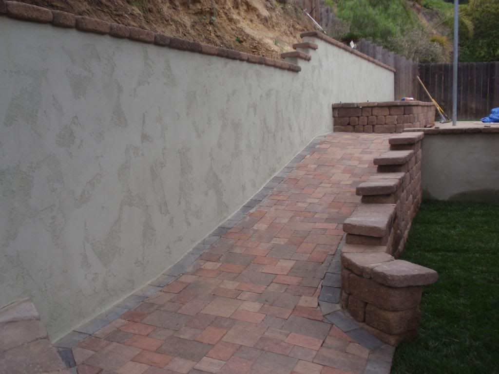 Gray stucco retaining wall google search lawn gnome Exterior wall plaster design