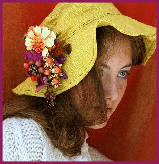 Beautiful brooches pinned to a hat