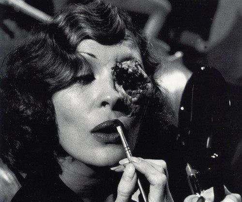 Faye Dunaway touches up her make-up during the filming of Chinatown's violent climax, 1974