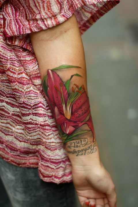 That is a beautiful flower, but the text is exactly why you should not be putting wrist tattoos on upside down. How dumb does that look?