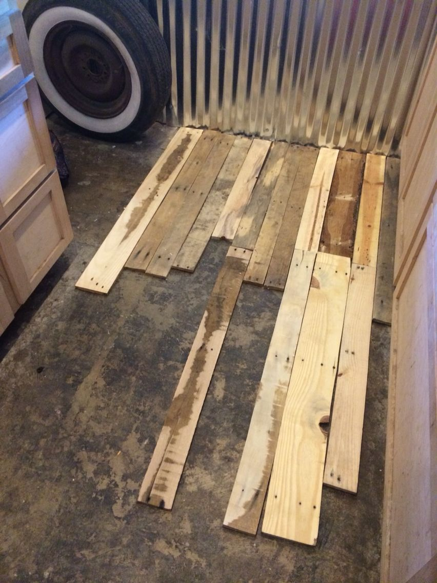 Pallet wood floor project from beginning to end done on a for Wood floor over concrete