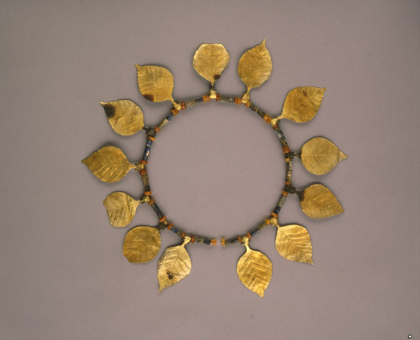 gold leaf and lapis bead