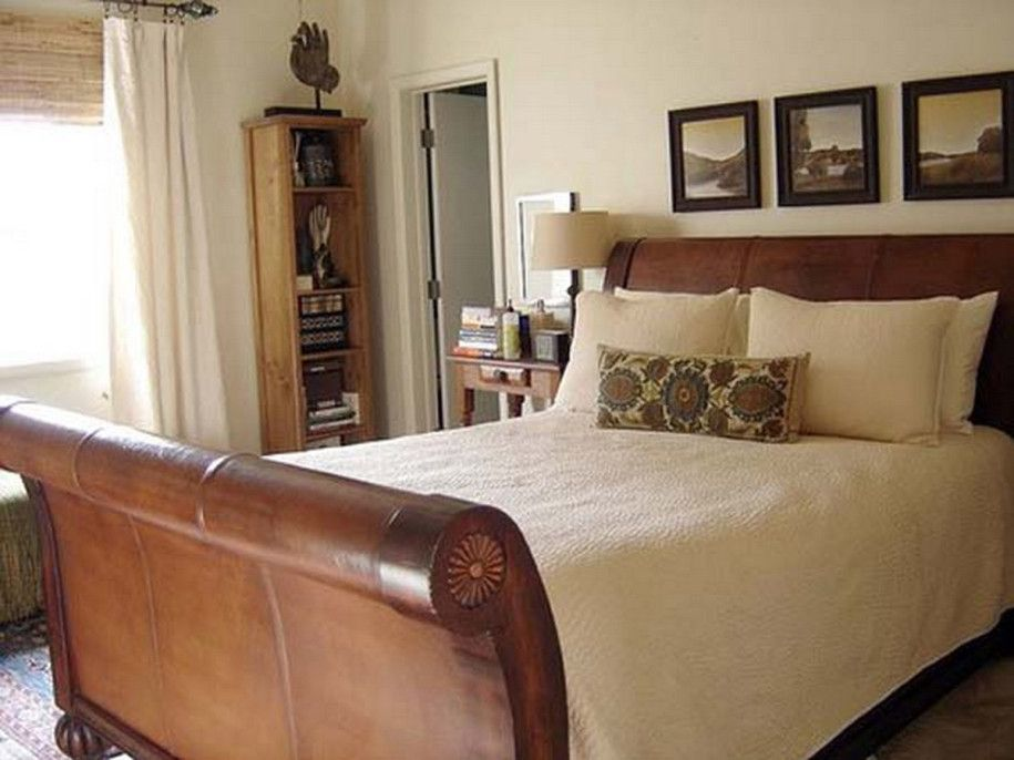 Rustic Sleigh Bed With Wooden Headboard Beige Bed Cover And Pillows And Table Lamp Beige Bed Covers Bedroom Design Moroccan Inspired Bedroom