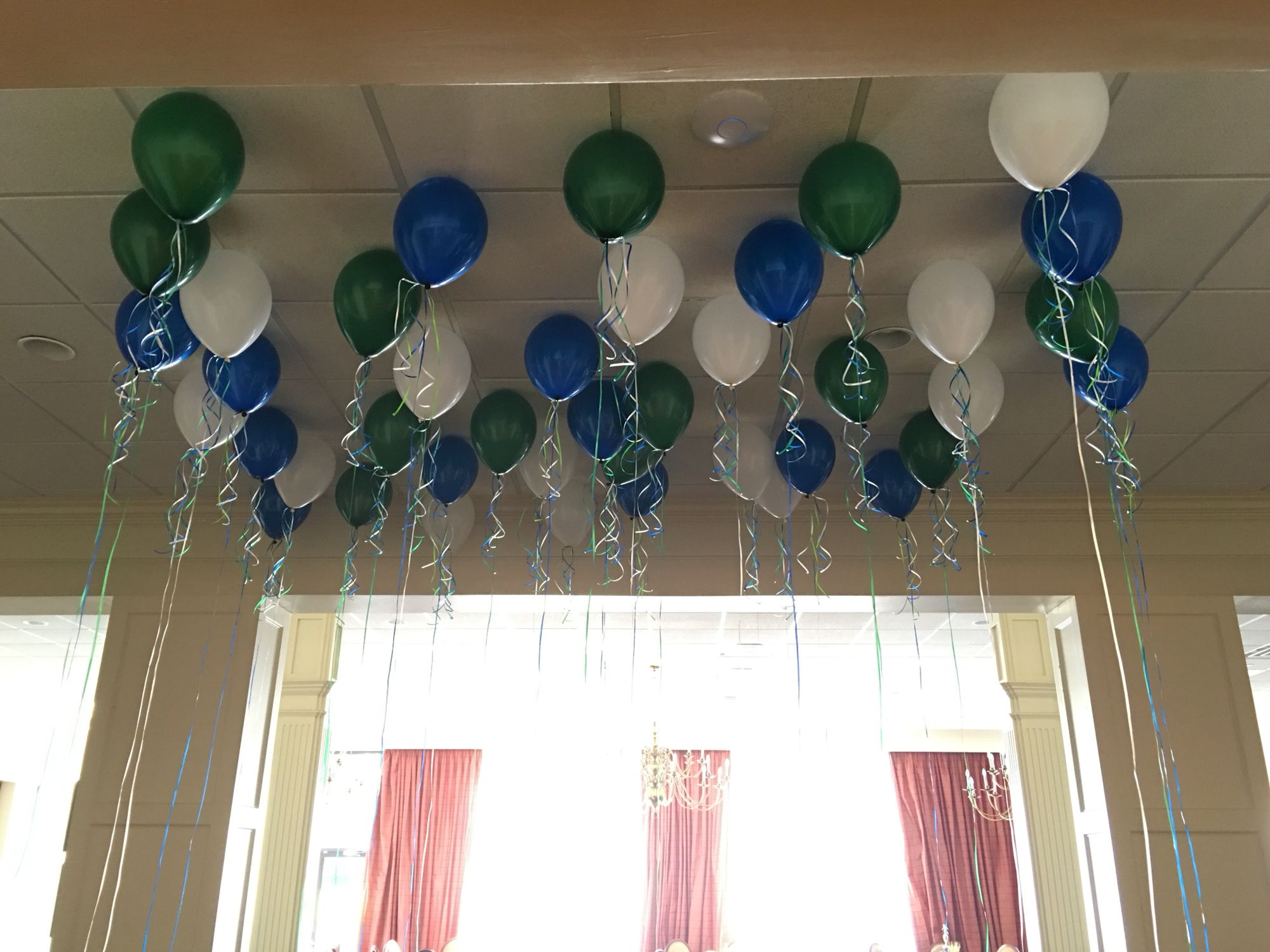 Let balloons hang free as a fun entrance to a middle school sports banquet.
