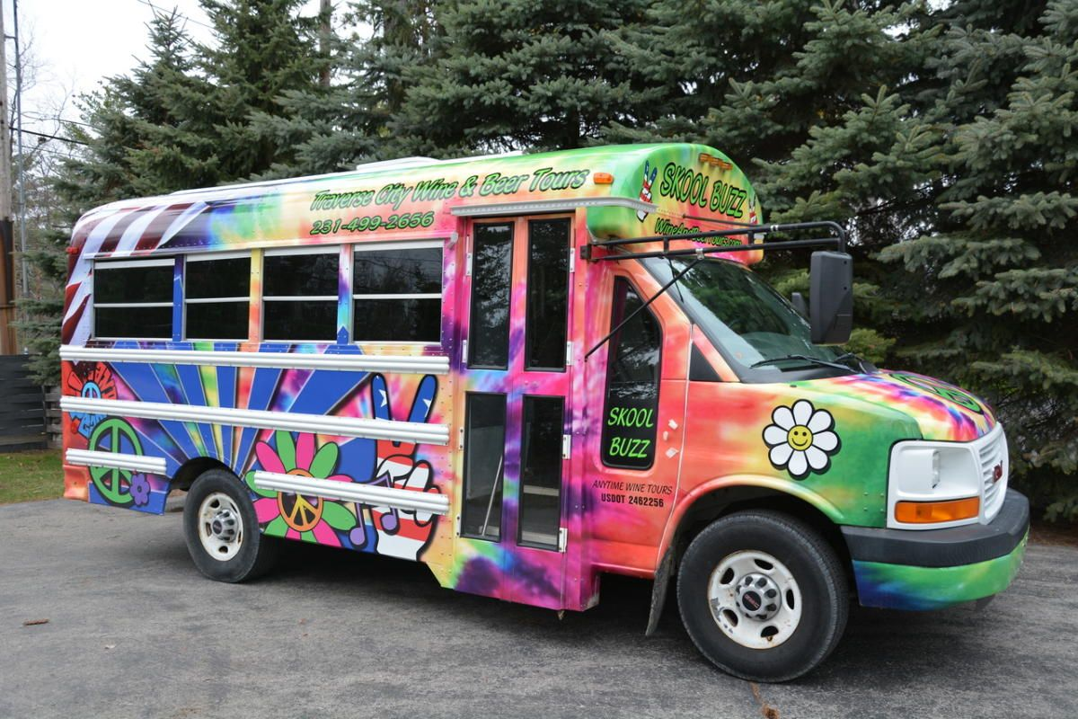 Check Out Our Kool Bus With The Funky Tie Dye Wrap Leave The Driving To Us Wile You Relax And Enjoy Plan Your Traverse City Wine Tour Beer Tours Wine Tour