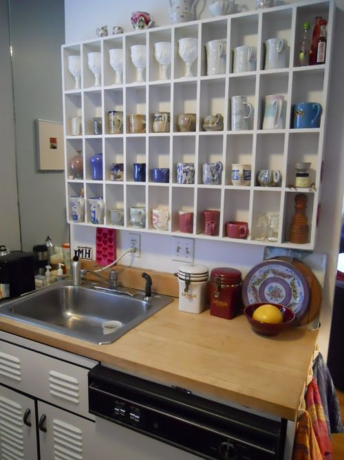"""When architect Gary Glenn was asked to come up with a renovation plan for a condominium in 1981, he was instructed by his client toretrievethe cabinets and stovefrom a scrap pile ofitems otherhomeowners in the 1929 building had discarded while updating their units.The cabinets he salvaged, bearing the label """"Murphy Cabinette,""""were made by the Murphy Bed Company. The finish on the cabinets is porcelain on metal with black edges and handles; the gas stove and oven still work after 80…"""